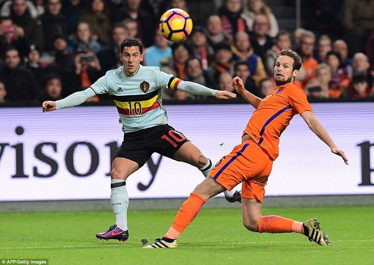 Chelsea playmaker Eden Hazard crosses for Belgium as Manchester United defender Daley Blind is beaten for Holland