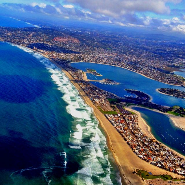 Mission Beach, CA.  One of my favorite beaches in California.  I have been to many but this particular one is amazing.  I hope to take my wife there as well :)