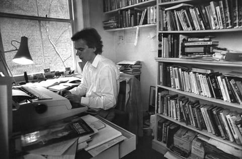 Martin Amis, working on a novel in April 1990