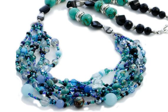 The Ariel Statement Necklace is Boho inspired with multi-strand of mixed beads and crystals in blue and turquoise tones.    Ariel Statement necklace is 70cm in length including the S-hook and eye clasp.    Brighten your day appearance and feel amazing wearing the Ariel Statement Necklace.    Looks amazing with jeans and a white top and also looks elegant in the evening with a dress.      Code: KTC-284    (Colours may vary from screen to screen depending on settings)…
