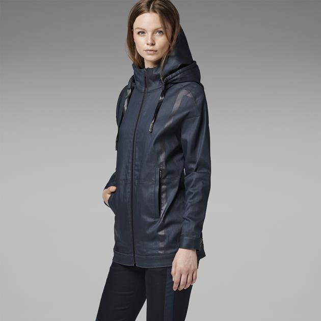 Long bomber with mesh inserts and a double-layer hood. Rubberized details trim the front and back of the body.