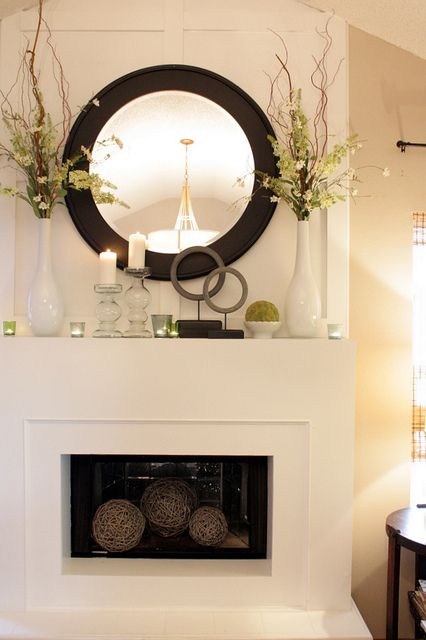 Love this mantle decor - ours is so boring right now!  Maybe need to switch out the picture for a nice big mirror.  Especially love the contrast of this round mirror.