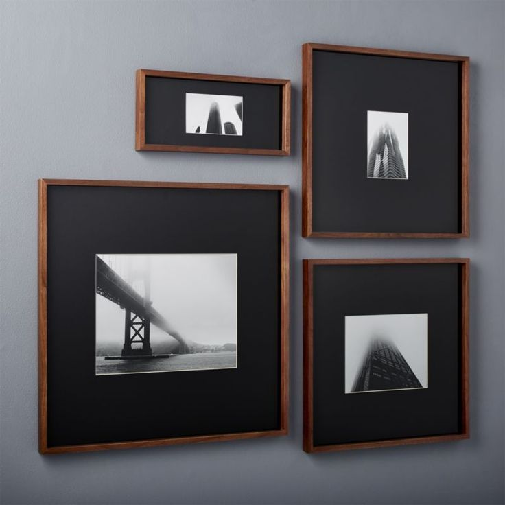 Shop gallery walnut picture frames with black mats.   Exhibit your favorite photos gallery-style.  Creating a display of modern proportions, oversized black mat floats a single photo within a sleek frame of warm walnut.