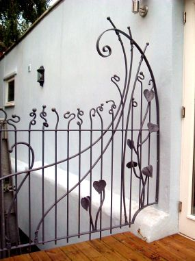 Artist Blacksmith Sam Bailey designs bespoke metalwork including gates, railings and sculptures - side panel railing