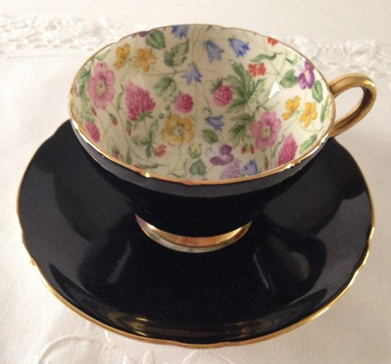 Wonderful vintage Shelley bone china tea cup and saucer, made in England. A lovely duo in black, Henley shaped with the Summer Glory pattern