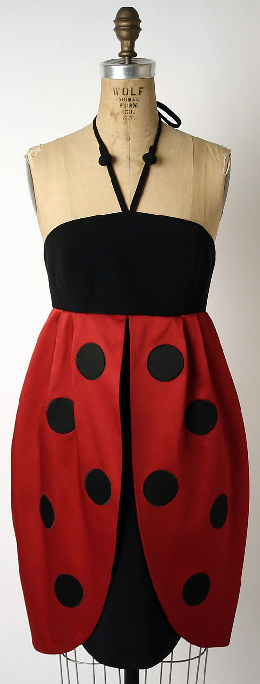 """Coccinella"" (""Ladybug"") dress  House of Moschino  (Italian, founded 1983)    Date:      fall/winter 1995–96  Culture:      Italian  Medium:      silk  Dimensions:      Length at CB: 37 in. (94 cm)  Credit Line:      Purchase, Gifts from Various Donors, 1998  Accession Number:      1998.164.3"