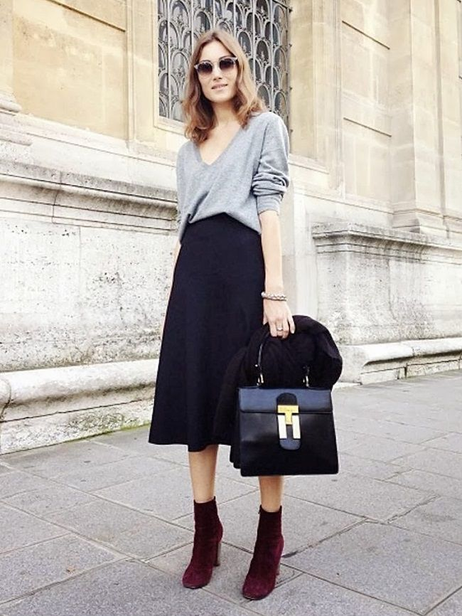 Giorgia Tordini in grey top, black midi skirt and burgundy velvet boots