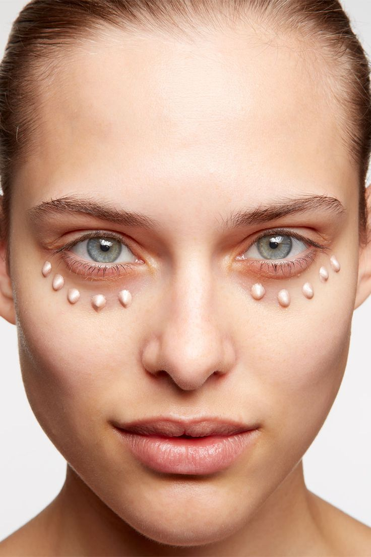 """Step 1: Dot a luminous primer along your orbital bone. """"This will give the concealer something to adhere to,"""" Napoleon says."""