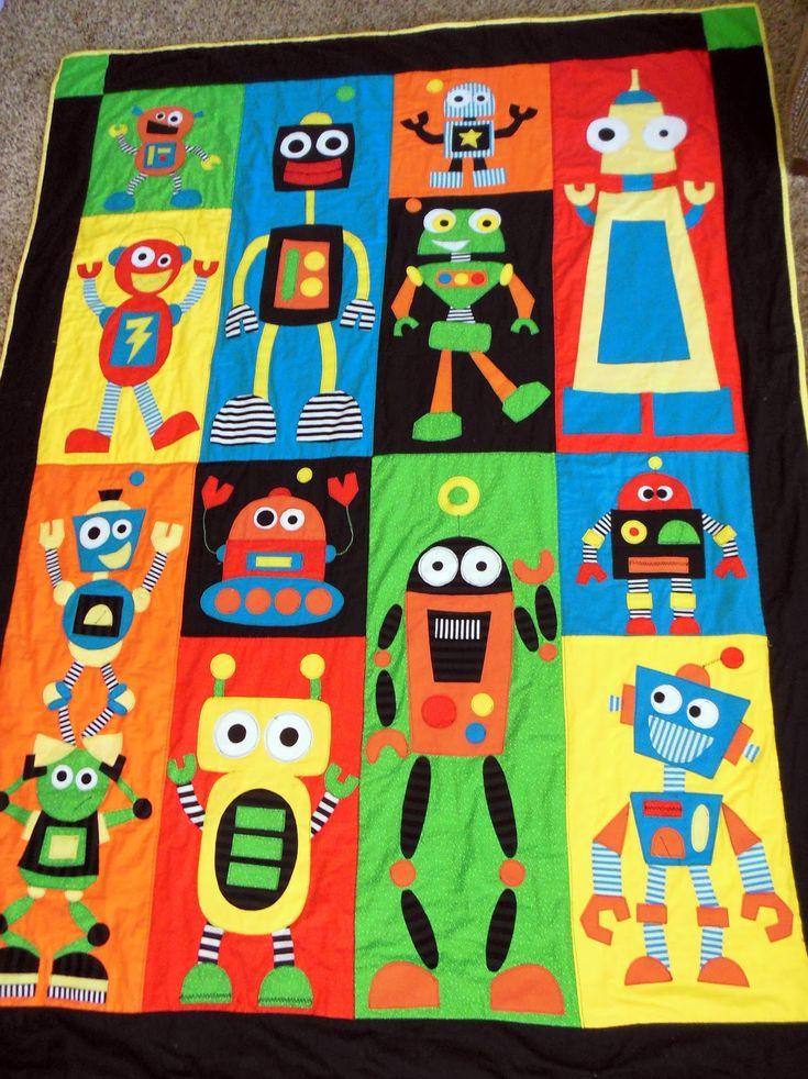Quilt infantil con figuras de simpaticos robots