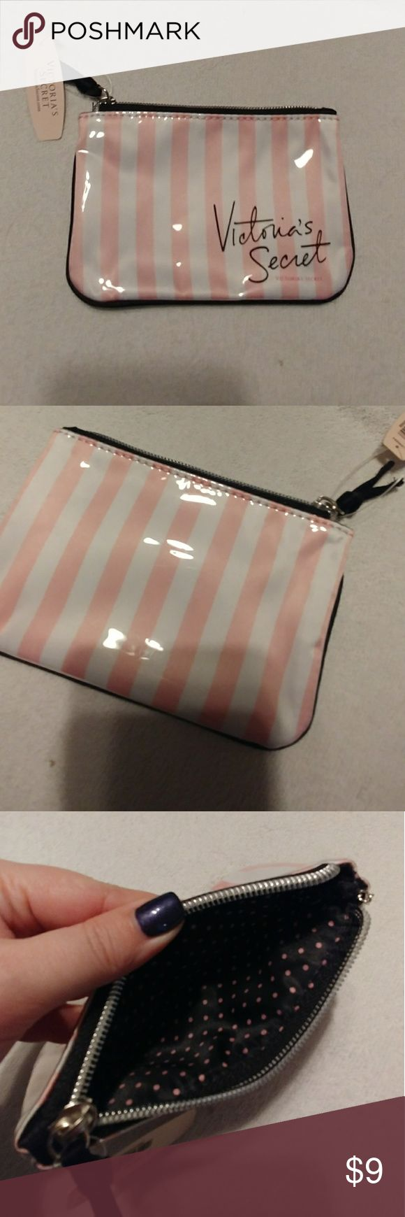 Victors Secret Wristlet Brand new with tags and never used. Pretty pink and white striped design. Perfect size for cards, cash, lip gloss and id.  It has a key chain link for keys too. Victoria's Secret Bags Clutches & Wristlets
