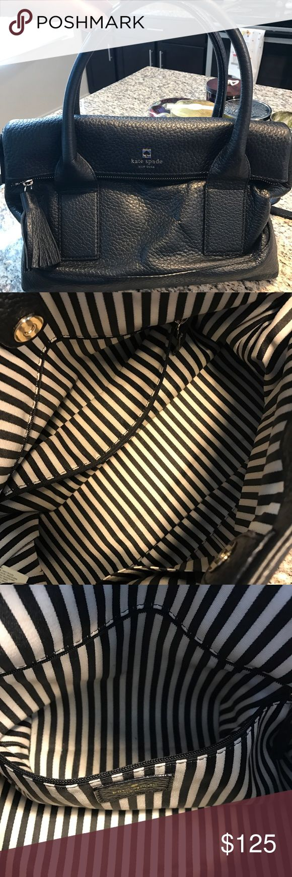 Kate spade handbag Gently worn. Nothing on the exterior of the bag, only one little blue mark on the inside small part of the purse that's hardly noticeable you can't even notice in the picture and maybe just natural signs of wear on inside but nothing noticeable, as you can see in picture. Comes with original dust bag as well. I'm super sad to part with this but I'm having a baby and I know I'll never use this handbag want to go to a good home! This is a cross-body as well kate spade Bags…