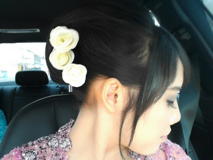 It's called sanggul in my country. And i love this hair do