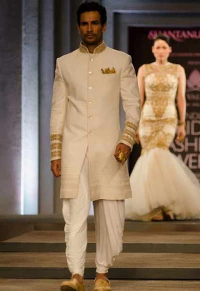 Shantanu-Nikhil's gold-ivory combination for a long jacket with dhoti pants is eye-catching.