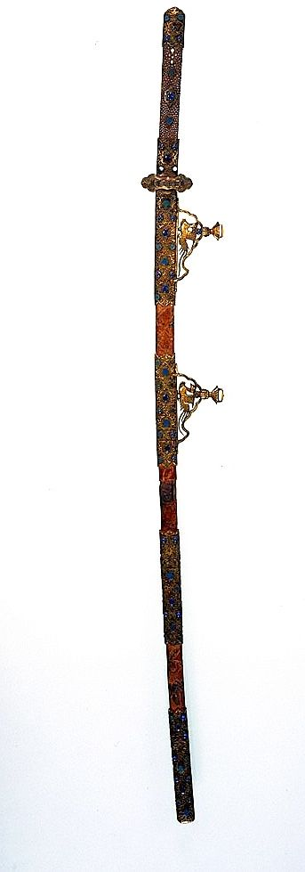 kazari-tachi koshirae.  With mother-of-pearl inlay decoration and gold fittings on ikakeji lacquer ground.    Overall L. 110.0. Heian Period (794 to 1185) 12th century. Important Cultural Property.