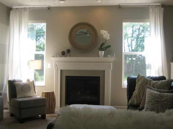 The majority of our home is painted in Valspar (Lowe's) Bonsai.  It's a light, airy gray that changes throughout the day.  In the afternoon it takes on a greener hue and at night a taupe-y hue.  It's the color of our main living space:  family room, kitchen, dining area and sunroom.  It's the color of our 2-story foyer and bedrooms also.