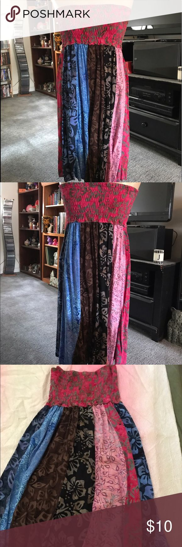 A cute strapless sundress with a floral pattern Strapless sundress great for going out or to the beach New never been worn Hawaiian Style Dresses Strapless