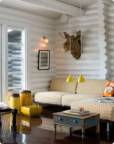 A giant moose head on a wall of white lacquered logs could have kicked the kitsch factor over the edge. Instead, weathered furnishings and sophisticated fabrics offer a perfect balance. Source