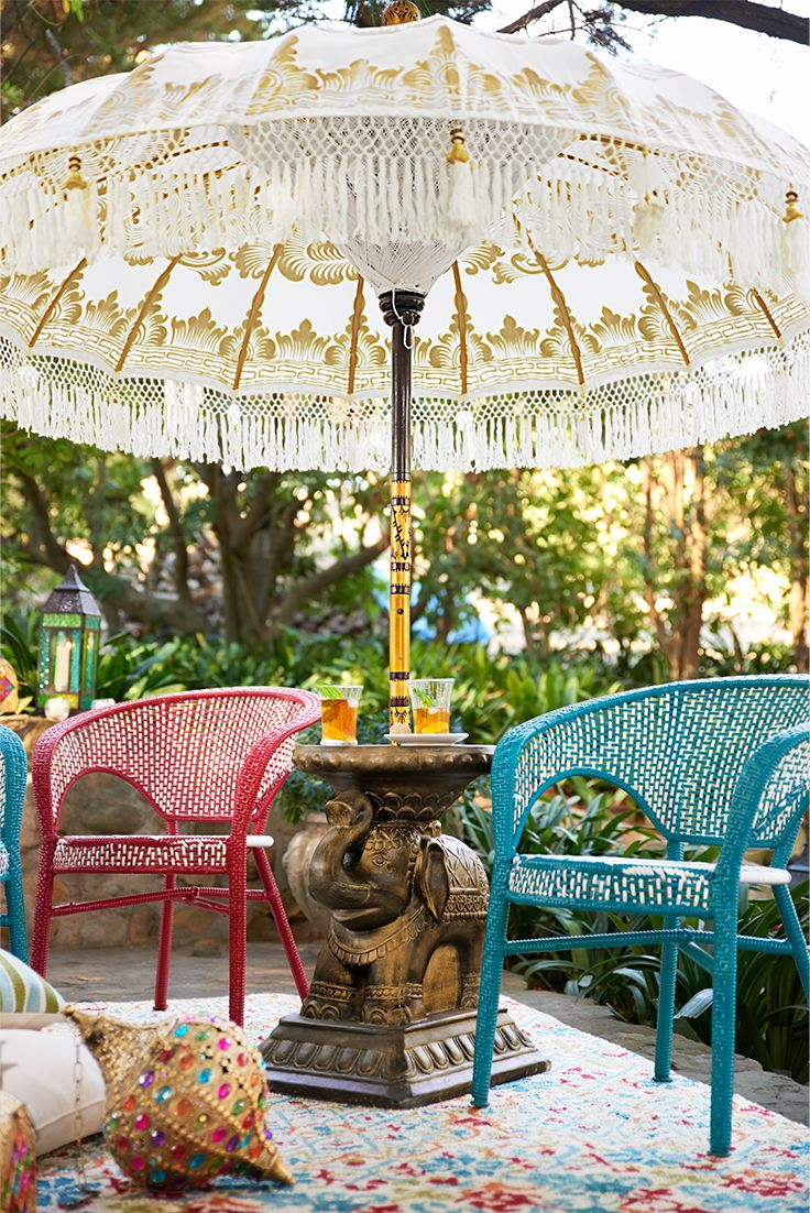 This spectacular fringed, tasseled and ornamented Balinese Umbrella from Pier 1 is entirely handcrafted in Bali—from the carved pole to the intricately hand-gilded canopy. Each umbrella is one of a kind and takes 10 days to create. Often used in its native land for festive ceremonies and parades in colors to reflect the occasion. In this case, white represents purity, peace and knowledge.