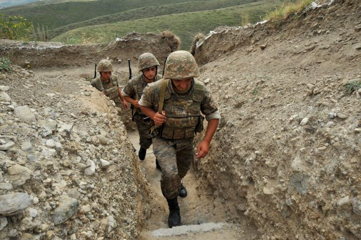 Armenian soldiers of the Nagorno-Karabagh Defense Army patrolling the border trenches on the disputed border with Azerbaijan.