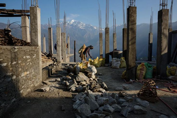 Villagers rebuild houses and pathways in the Himalayan village of Barpak, in Gorkha district, Nepal, at the epicenter of the April and May  2015 earthquakes which killed 9,000 people, April 6, 2016.