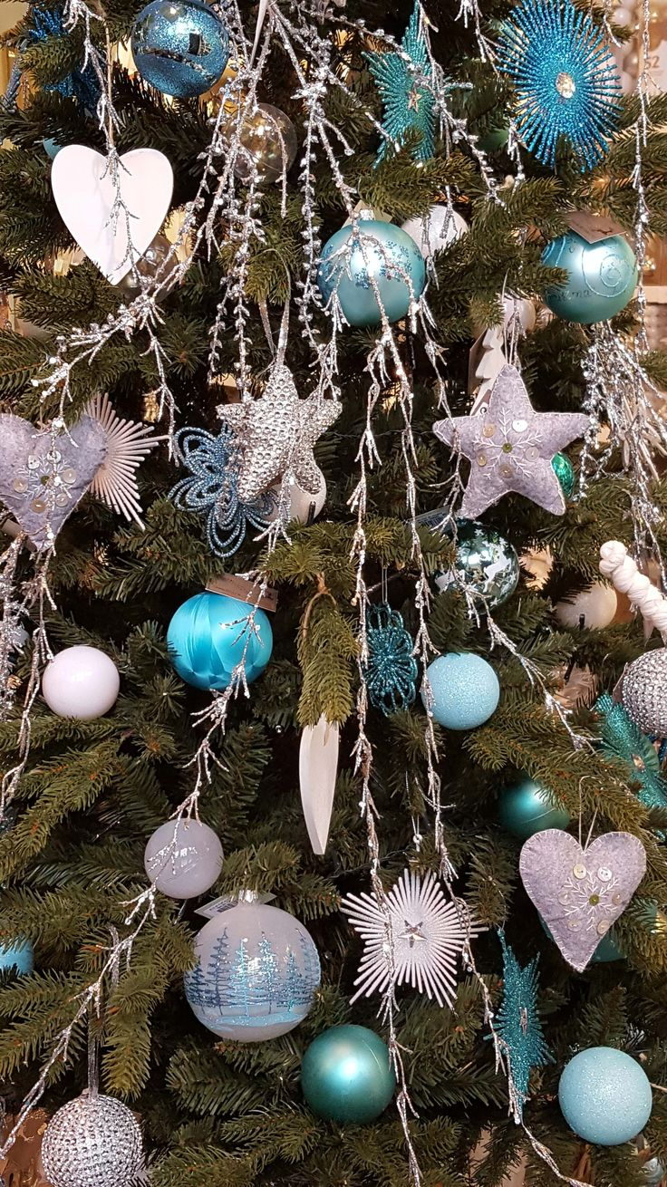 Ice blue, teal, white and gray are primary colors in this frozen inspired Christmas tree | It's all about Christmas