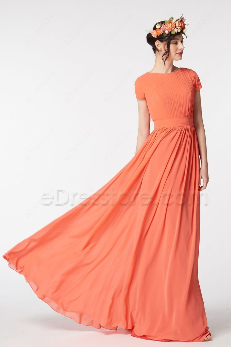 The coral bridesmaid dress features O neckline and pleated top and short sleeves, gathered A Line skirt finishing with floor length.