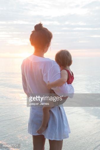 Stock Photo : mother and baby son at the beach in thailand