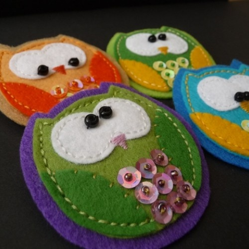 Felt owls decorated with old buttons, sequins, etc.  Small project in which I can use old material that I might only have in small quantities.  I could make this into a mobile and have different colours on each side of the owl; I could glue a small family of  them onto driftwood or make a colour book out of them.