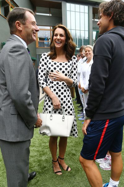 Catherine, Duchess of Cambridge, Patron of the All England Lawn Tennis and Croquet Club (AELTC) with Sir Philip Brook (left) chairman of the of the AELTC on day one of the Wimbledon Championships at The All England Lawn Tennis and Croquet Club, Wimbledon on July 3, 2017 in London, England.