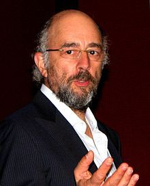 Richard Schiff (born May 27, 1955) is an American actor. He is best known for playing Toby Ziegler on the NBC television drama The West Wing, a role for which he received an Emmy Award. Schiff made his directorial debut with The West Wing, directing an episode entitled Talking Points.