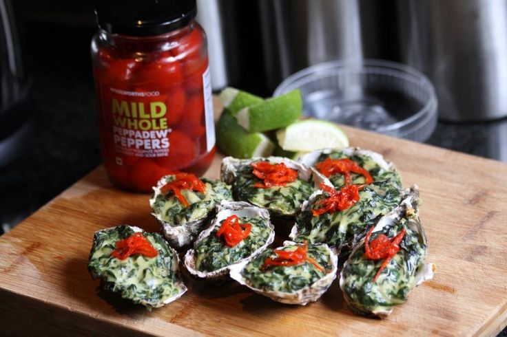 """Oysters topped with creamed spinach and peppadew""""s"""