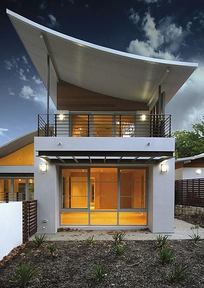 Bold roof designs feature COLORBOND® and ZINCALUME® steel in these two homes in Canberra.
