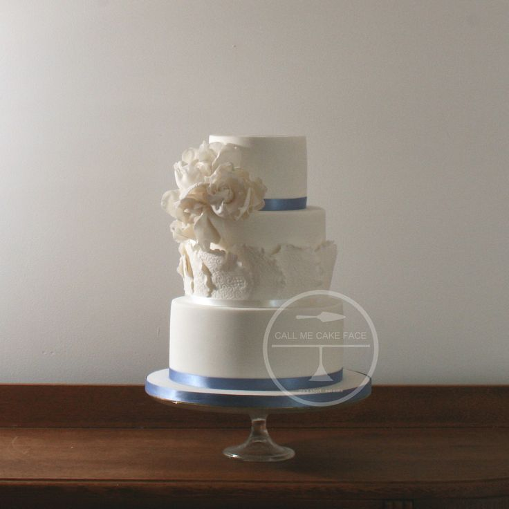 Petite cake with sugar doilies and sugar flowers.