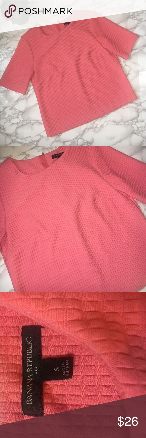 """Banana Republic Short Sleeve Top Banana Republic Factory Short Sleeve Top in coral. Raised knit pattern. Short sleeve. Zipper on the back. Length is about 21"""". Armpit to armpit is about 18"""". EUC. Banana Republic Tops"""