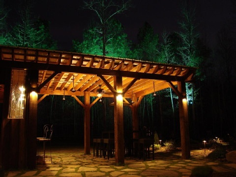 Orion sconces highlight the pergola's beams while the ...
