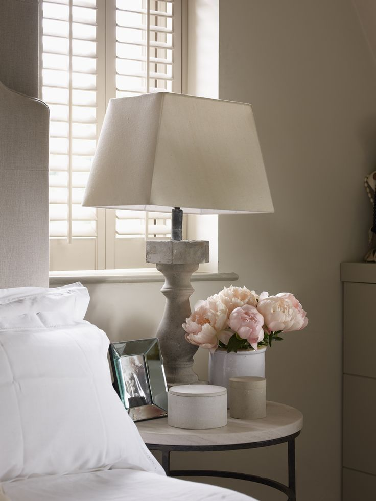 European Bedroom Features A Gray Linen Headboard On Bed Dressed In White  Linen Bedding Beside A Round Iron And Stone Bedside Table Topped With A  Baluster ...
