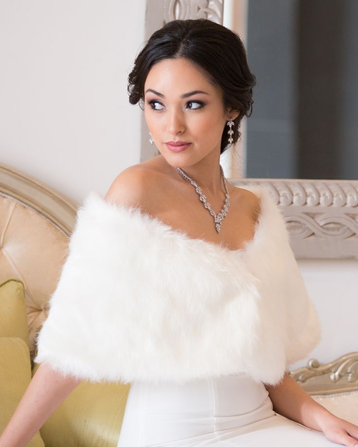 Bridal Wrap by Mariell. Calling all winter brides! This stunning faux fur wrap will not only add the warmth you need for your winter wedding, but will be a show-stopping topper to your wedding gown. I