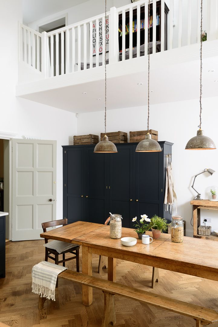 The perfect breakfast table with vintage pendant lights and a big deVOL larder cupboard and integrated fridge/freezer