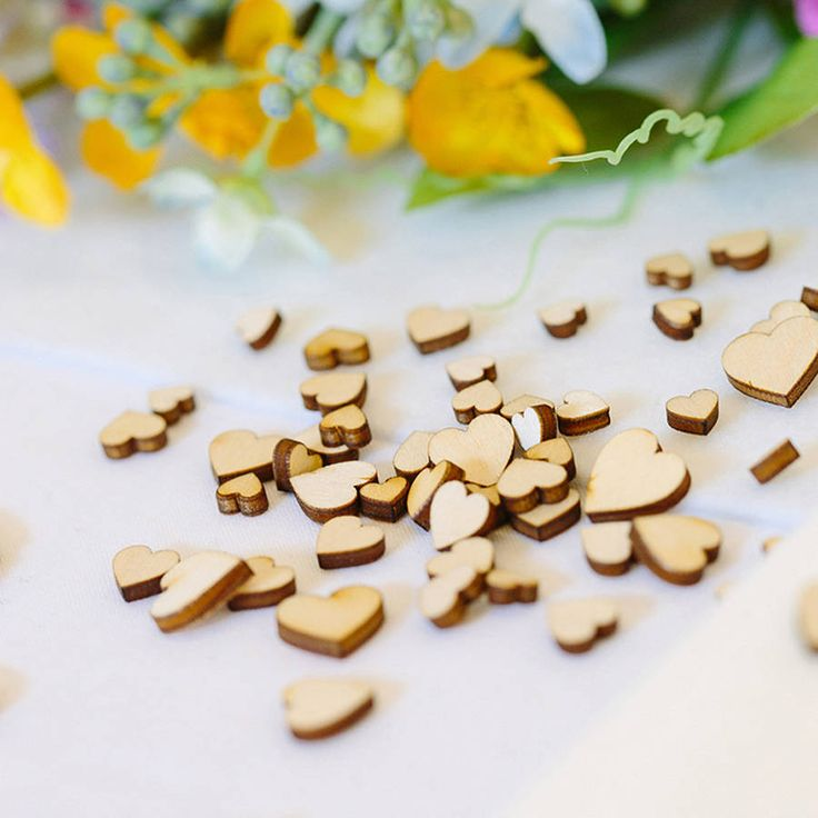 Mini wooden love scatter hearts. Add a bit of rustic style to your table with these wooden love hearts. Designed by us to use as wedding table decorations to scatter or to use on any other table where there is a celebration. These hearts are also perfect to use as embellishments on cards and craft projects.Designed and made by us in the UK from 2.5mm lightweight Birch/Aspen wood.Various sizes ranging from 0.6cm -1.5cm. Approx 60-70 hearts per pack.