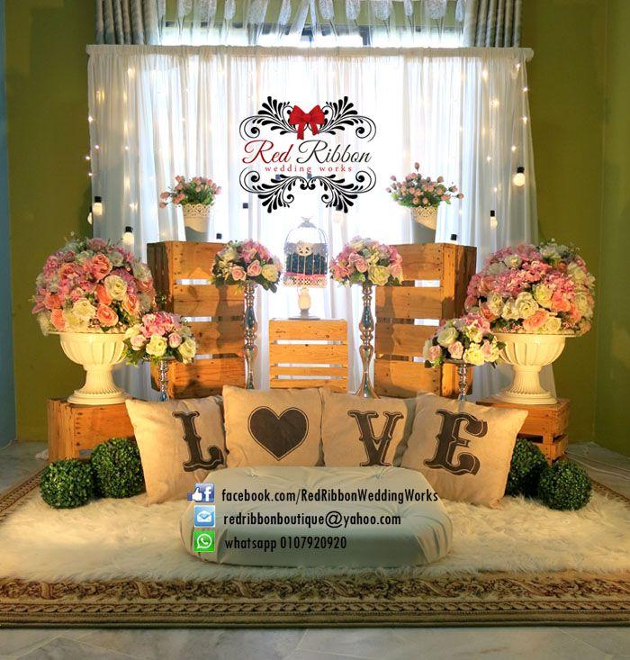 #pelamin #tunang #sweet #rustic dengan sentuhan #pink flowers. for the new concept of rustic wedding :)