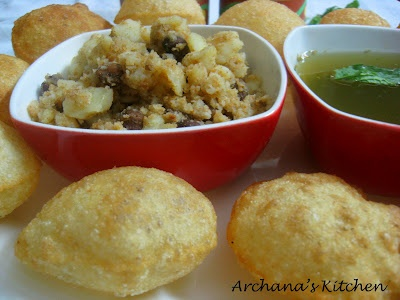 Calcutta Style Puchka -  Little puffed and crips puris, stuffed with spiced poatoes, then dipped in tangy spicy flavored water and eaten as a whole! (Indian street food recipe)