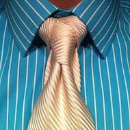 the cape necktie knot white tie on a teal/whit striped shirt | See more about Necktie Knots, White Ties and Striped Shirts.