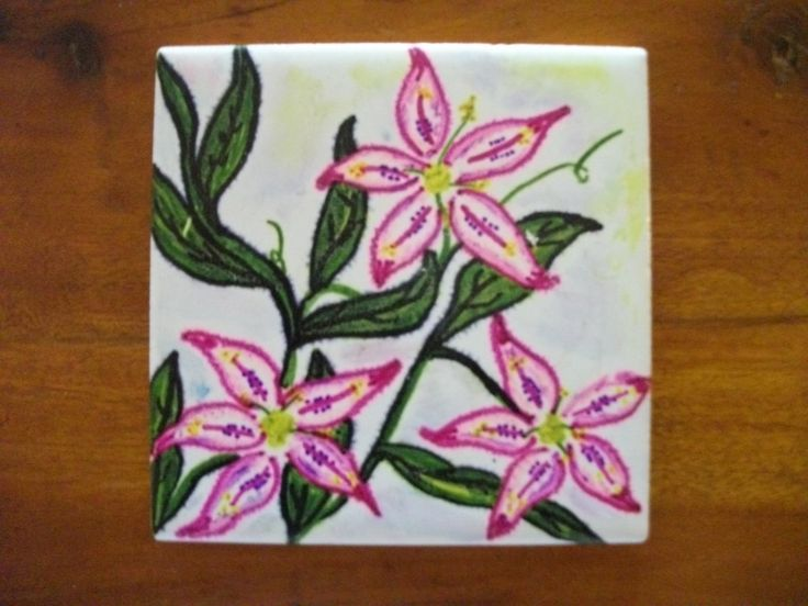 Create your own art piece on a ceramic tile using permanent markers. They make great gifts for loved ones they can cherish forever.