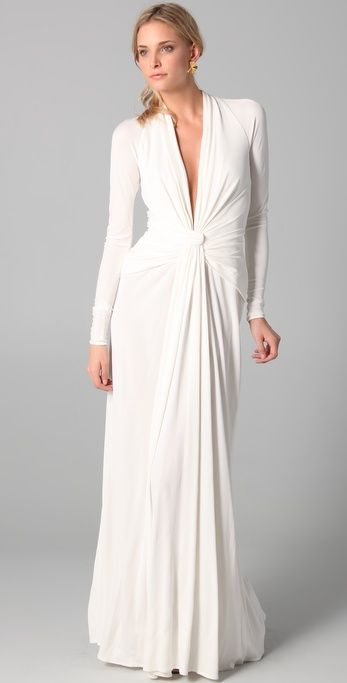 ISSA Long Sleeve Open Back Wedding Gown : Issa's signature gown style rendered with elegant long sleeves. Soft draping at the front and waist. Hidden back zip. Semi-sheer. Unlined.
