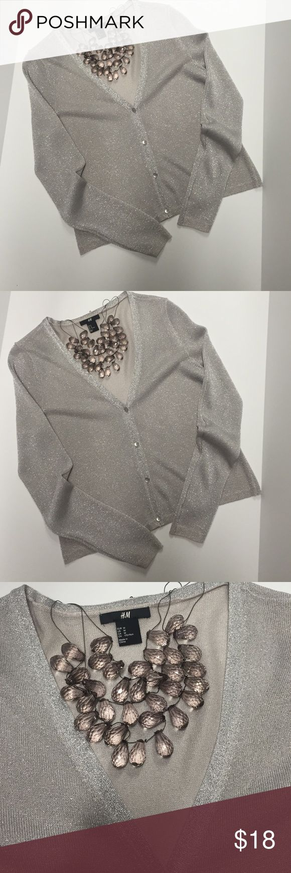 🎉 FEELING FESTIVUS 🎉H&M Silver Metallic Cardigan 🎉 FEELING FESTIVUS 🎉 H&M Silver Metallic Cardigan 🎉 Classy/Dressy/Pretty Pretty ✨ for the on the town look or casually staying in but want that sassy pretty fine ✨ 61% viscose 25% polyester 14% metallic sized fibre ✨ H&M Sweaters Cardigans