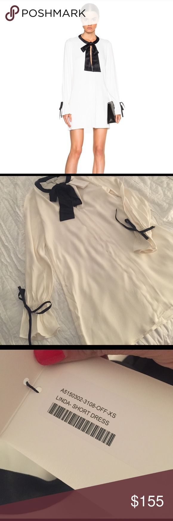 ALEXIS Linda short dress in white NWT blouse style dress with black accent bows to sleeves and neck ALEXIS Dresses Long Sleeve