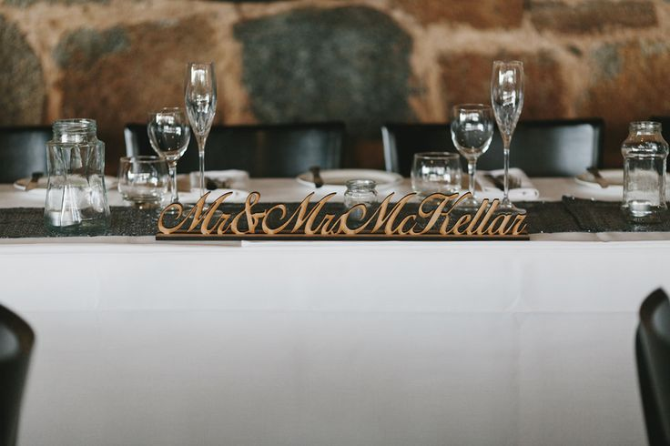We love our rustic Mr & Mrs bridal table piece...