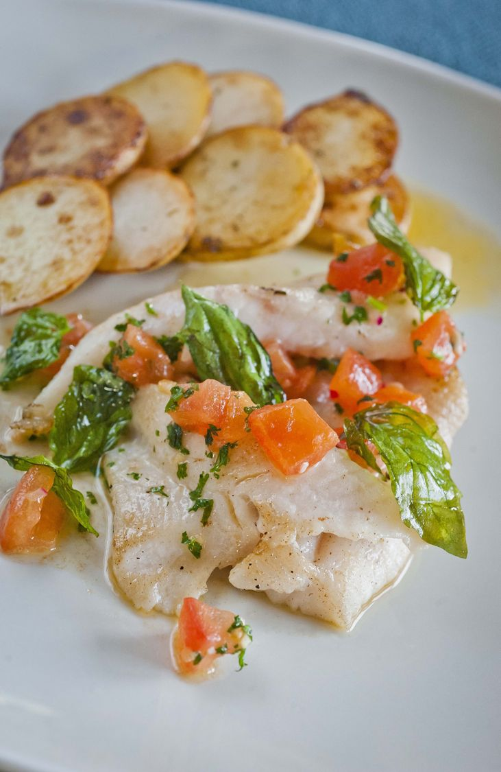 John Dory with Herb and Tomato Butter - This recipe is simple to make, but eye-catching and delicious nonetheless - http://www.fishisthedish.co.uk/recipes/main-meals/1434-john-dory-with-herb-and-tomato-butter