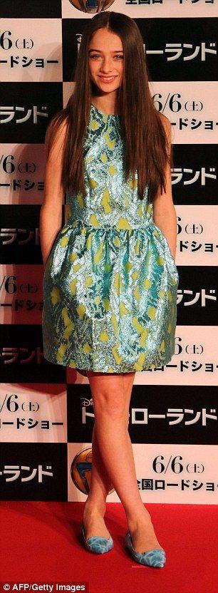 Glitzy: Fellow actress Raffey Cassidy chose a metallic blue and green party dress...