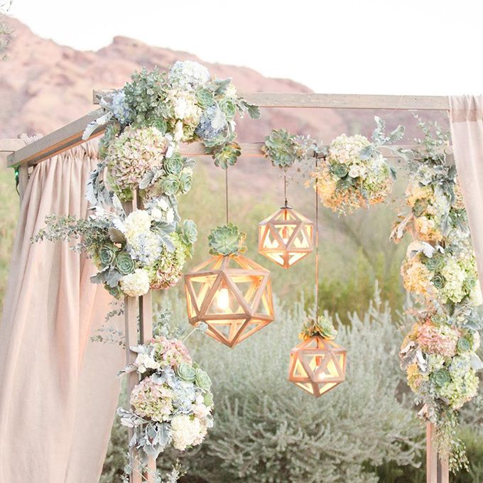 "Brides.com: . Geodesic pendant lights adorn a romantic chuppah of weathered wood and gauze curtains, casting a soft glow where the bride and groom say ""I do."""